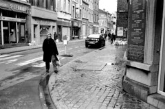 Liege (Peter Gutierrez) Tags: street old city houses people urban bw white black streets film public shop contrast town photo europe european belgium belgique belgie pavement decay centre belgi center sidewalk peter shops gutierrez belgian liege narrow centrum luik contrasty lige wallon wallonie wallonia liegois wallone petergutierrez ligois liegoise ligoise liegoises ligoises