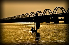 sunset @ Rajumandry bridge (naveen kumar boidapu) Tags: bridge sunset people india reflection water boat amazing nikon awesome boating 1855 lovely andhra pradesh vizag d3100 rajumandry godavrai