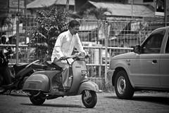 Ready To Go (Fajar Pangestu) Tags: people bw white man black monochrome indonesia blackwhite nikon vespa scooter motorcycle westjava bogor ipb d3000 nikond3000 bogoragriculturaluniversity rexar135mmf28 welovebogor