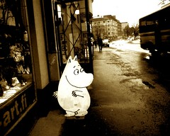Rogue Moomin on the loose in Helsinki (Ali Molloy) Tags: cameraphone street sepia finland helsinki europe sony cartoon cellphone moomin