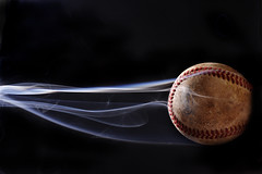 Fastball (italian.meatball) Tags: black sports field speed canon baseball smoke smoking sharp flame slider fastball curveball gyro sinker seams 40d mywinners
