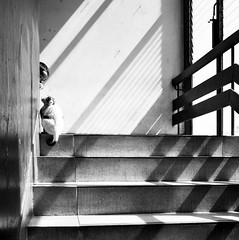 "Unsure cat & boy - hospital stairs, Issan, Thailand                                (to the cat & boy at least, this appears to be a ""Decisive Moment"") (Sailing ""Footprints: Real to Reel"" (Ronn ashore)) Tags: people thailand asia faces unsure feelings issan canoneos5d 10faves shotsthatrock somethingintheair fivestarsgallery misgivings thelittledoglaughed artlibre bnanimali bnpersone aplusphoto afeelingofuncertainty hospitalubonratchathanidecember2007cats masterpiecesoflightanddark thecatwhoturnedonandoff"