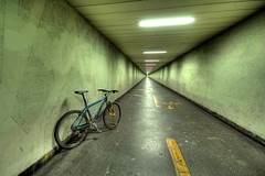 a green bike in the green tunnel; waiting for something in an other color (Toni_V) Tags: green bicycle topv111 1025fav switzerland klein zurich perspective tunnel mtb 2008 d300 sigma1020mm enge toniv diamondclassphotographer flickrdiamond toniv ulmbergtunnel