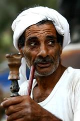 Narjeela Smoker (AHMED ALKHUZAIE  ) Tags: old portrait man 20d canon bahrain smoke sigma oldman smoker smokes ahmed 70200 sheesha karana  sigma70200     narjeela     alkhuzaie