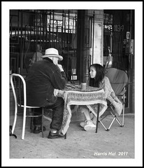 Tarot Card Reading - Commercial Drive S1020e (Harris Hui (in search of light)) Tags: bw canada vancouver lost blackwhite bc candid streetphotography richmond confused fujifilm digitalbw littleitaly fortuneteller commercialdrive pointshoot fortunetelling thedrive candidportrait digitalcompact s1600 vancouvereast fujis1600 tarotcardreading harrishui vancouverdslrshooter takecontrolofyourownfuture