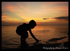 silhoutte of a child ( Ahmed Amir) Tags: november sunset sea colour beautiful canon bravo child unique amir unclassified maldives ahmed soe silhoutte blueribbonwinner flickrsbest golddragon abigfave specialtouch anawesomeshot diamondclassphotographer flickrdiamond flickrchallengewinner theperfectphotographer