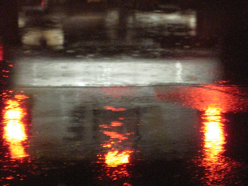 Reflected Tail Lights and Rain