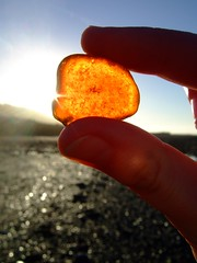 piece of amber! (lisaluvz) Tags: light sea sky orange sun beach glass wales coast amber fingers shore washed coloured combing blueribbonwinner lisaluvz