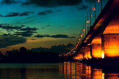 Sultan Mahmud Bridge, Kuala Terengganu (DSC_0810) (Fadzly @ Shutterhack) Tags: city travel bridge light sky cloud holiday hot nature water night reflections d50 river catchycolors landscape asian lights interestingness nikon asia published sundown zoom natureza low natur natuur fast natura noflash telephoto malaysia tropical vista tropic scape paysage  asean  terengganu equator humid landschap publish mys   maleisi charakter  explored  sigmaapo70200mmf28exdghsm nikonstunninggallery kalikasan losong shutterhack jambatansultanmahmud tsunamiinthesky enlightedbridge helpsaveourearth beautifulhour