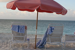 Beach Chairs at dusk, Turks and Caicos (cosmo-girl) Tags: travel pink sea vacation sky abandoned beach colors umbrella sand view dusk furniture scenic carribean beachlife tourist used parasol shade towels whitesand oceanview lounger chaise lamer seaview beachchairs turksandcaicos blueandwhite sunlounger beachchair sandybeaches gracebay gracebayclub oceanclubwest gracebaybeach seasandsky