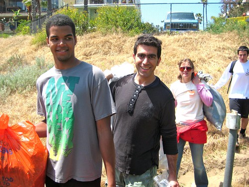 Volunteers Carrying Bags Full Of Trash And Debris From Ballona Creek