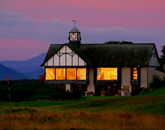 Reflected Sunrise, Royal Dornoch Clubhouse 18th October 2007 (foxypar4) Tags: morning red orange mountains reflection green window sunrise golf dawn scotland october 18th sutherland dornoch golfclub royaldornochgolfclub royaldornoch colorphotoaward superbmasterpiece amazingamateur