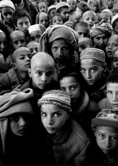 Afghanistan War orphans (nick rain images) Tags: world poverty uk portrait people afghanistan boys kids america children soldier photography kid fight eyes war asia peace control muslim poor picture photojournalism location orphans human mines landmines conflict 2008 survival struggle kabul survivor global survivors taleban