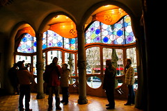 Barcelona 3 (Lady Vervaine) Tags: barcelona wood windows light people church window mushroom glass stone architecture flow spain soft glow arch natural interior columns arches stainedglass fluid espana architect gaudi round glowing column catalunya flowing organic curve curved rounded catalan peoplewatching stainedglasswindows casabattl