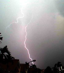 Lightning strike (Mangiwau) Tags: storm weather electric hammer indonesia hit jakarta tropical strike thunderstorm lightning thunder bogor hammering severe pounding sunda tangerang banten