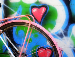 Bicyclove (jimiliop) Tags: street pink blue color green art love bike bicycle wheel wall happy graffiti colorful colours heart emotion spray lively cubism artisticexpression supershot flickrcolour abigfave p1f1 colorphotoaward aplusphoto colourartaward
