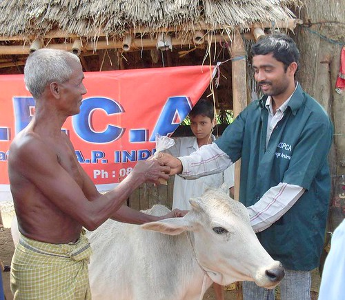 VSPCA aid worker and villager