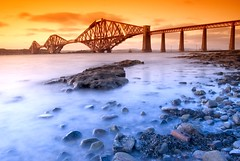 Forth Rail Bridge from South Queensferry II (Semi-detached) Tags: bridge sunset water landscape scotland nikon rocks long exposure angle fife south north wide rail wideangle structure estuary forth filter creamy loth