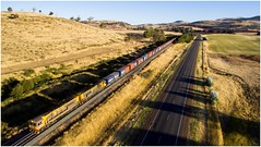 Late lighting at Woodbury (Trains In Tasmania) Tags: diesellocomotive australia tasmania tasrail aerial papertrain goodstrain freighttrain 32 332 no32 woodbury containertrain trclass tr hills caterpillar tr06 tr10 djiphantom3standard dji phantom3standard drone dronephotographyscenescenerytasmanian tasmanianscenery tasmaniancountryside trainsintasmania stevebromley latelighting road highway