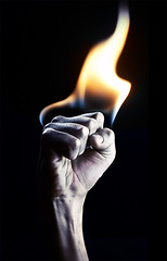YEAH! (magnusmagnus) Tags: light contrast photoshop fire nikon power expression 85mm fist heat strong f20 mywinners