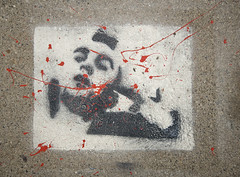 Travis Bickle (O Caritas) Tags: red white black campus concrete graffiti stencil paint michiganstateuniversity pavement michigan msu sidewalk eastlansing travisbickle taxidriver lightroom msusacredspace nikond200 walteradamsfield dsc3810 2007bypatricktpowerallrightsreserved 10november2007