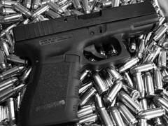 Glock 23 on a Pile of Ammo B&W (itwuzcryptic) Tags: white black macro blackwhite gun shoot shell smith case copper sw guns shooting 23 bullet 40 handgun bullets ammo ammunition lightbox cartridge glock firearm projectile caliber semiauto semiautomatic smithwesson hollowpoint wesson g23 glock23 hollowpoints