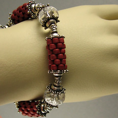 prayer wheel bracelet in brick red (yellowplumbeads) Tags: red beads colorful jewelry bracelet bead etsy beaded yellowplum beadwork seedbeads beadweaving beadedjewelry artisanjewelry peyotestitch handcraftedjewelry beadedbeads dawanda beadedbracelet boundlessgallery smashingdarling gourdstitch colorfuljewelry yellowplumbeads susanshaw etsymaine