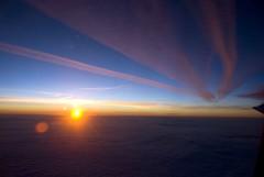 Happy Trails (tr1stero) Tags: pink blue sky orange cloud sun clouds sunrise inflight flight trails vapour vapor 2007 ipernity tr1stero