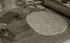 Anise Sugar Cookies (purpletwinkie) Tags: christmas bw food white holiday black cookies snowflakes pin cookie dough board 2006 rubber sugar cutting rolling scraper rolled anise cutters