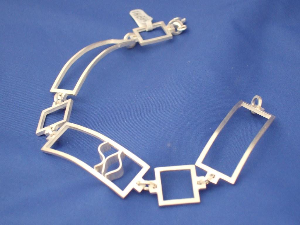 Silver Bracelet with wave motif.