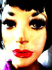 and drinks herself half blind... (DREASAN) Tags: portrait blur mannequin doll lashes feathers lola damaged plasticsurgery schaufensterpuppe puppe barrymanilow xy homesafari dreasan dreasanpics anafternoonwiththemannequinwhosharesmybedroom surgeryonplastic ©dreasanavb
