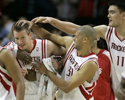 Yao Ming, Shane Battier and other Rocket teammates congratulate Steve Novak after he hit a game-winning 3-pointer to save the game for the Rockets and give them their 8th victory in a row.  Houston had blown an 18-point 4th quarter lead before Novak's shot.  Yao led all Houston scorers with 25 points and 14 rebounds.