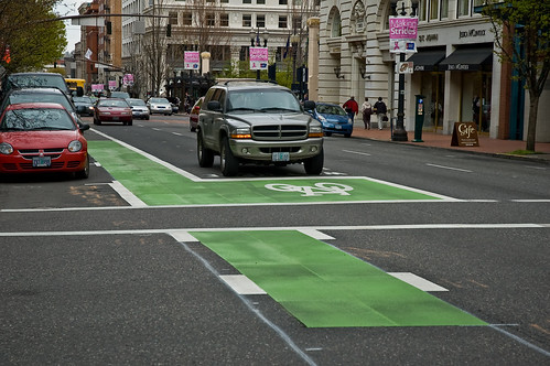 Bike Box: Brings cyclists to front of the line at traffic lights, priority crossing/turning, reduces right-hook conflict, fill in box with color paint to increase visibility. (Image Credit: Flickr)
