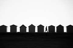 Hut Life [Explored] (ShrubMonkey (Julian Heritage)) Tags: beach huts shed shack coast coastal abstract contrejour mono bw candid person street si seaside silhouette sonyalpha