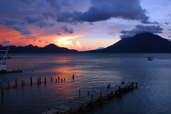 Sunset over Volcanos (Stacy Able) Tags: travel vacation portrait lake tourism nature nikon aztec stacy guatemala antigua mayan centralamerica pana guatemalan incan d300 brogan huehuetenango sunsetguatemala stacybrogan seedsofhelp guatemalalife