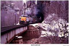 L&N 3557, 7036 & a GE (Robert W. Thomson) Tags: railroad trestle bridge snow ice train diesel tennessee railway tunnel trains locomotive uboat trainengine ge morley scl ln seaboardcoastline emd sd402 sd40 louisvillenashville sixaxle sdp35