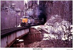 L&N 3557, 7036 & a GE (Robert W. Thomson) Tags: railroad trestle bridge snow ice train diesel tennessee railway tunnel trains locomotive uboat trainengine ge morley scl ln seaboardcoastline emd sd402 sd40 louisvillenashville sixaxle sdp35
