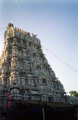 Thirupathi Gopuram (Jennifer Kumar) Tags: negativescan hindu balaji hindutemple tirupati gopuram andhrapradesh tirupathi templetower thirupathi thirupati venkateshwara templeart hinduart balajitemple india1998 templecarvings
