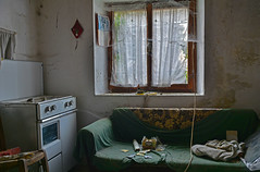 residential building PD02 #8 (jourbexia) Tags: decay decayed decaying derelict dereliction abandoned disused empty europe european urbex urbanexploration urban exploration building buildings rural ruralexploration architecture house houses italy italian indoors interior inside window windows cobweb wobwebs web webs cobwebs sofa setee couch green lounge livingroom cooker