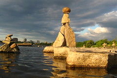 Balance of Power (zJMac) Tags: world park light sunset shadow summer sky sculpture sun white plant ontario canada cold reflection eye tower nature mushroom water rock wall clouds standing canon river dark daylight day waves shadows power view pyramid cloudy ominous ottawa watching floating sunny rapids balance lonely ripples placement inukshuk illuminati babel remic zjmac