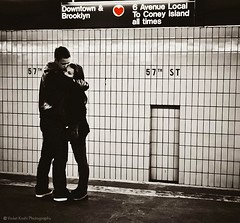 Subway Love (Violet Kashi) Tags: nyc newyorkcity red love monochrome brooklyn train underground subway couple downtown heart candid platform romance system midtown transportation mta 57thstreet