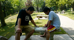 Epic Battle.... (L. Asuncion) Tags: park chess keith games tony greenlake lumixdmcfx07