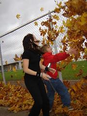 Heather & Jareth having fun throwing leaves! (tiffs pictures) Tags: family autumn smile heather laughter jareth weirdfun flickrchallengegroup flickrchallengewinner