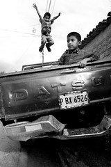 Free Thinker (Jacob K. Cunningham) Tags: poverty city people blackandwhite bw playing kids truck children locals action candid citylife streetphotography honduras sean tegucigalpa lapaz steet establishing marcala amazingtalent anawesomeshot jacobkcunningham jacobcunningham