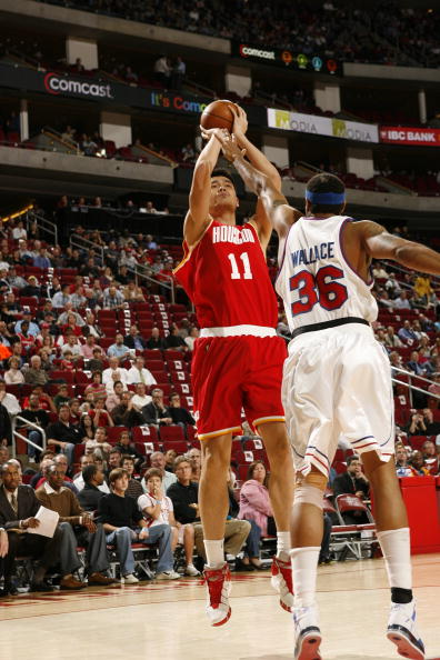 Yao Ming shoots over Detroit's Rasheed Wallace Wednesday night.  Yao scored 21 points, grabbed 13 boards, had 3 assists, and blocked 4 shots.  He also hit some big shots in the fourth quarter that were instrumental to a close 80-77 win.