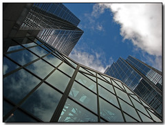 Glass and Sky (Lisa-S) Tags: blue sky toronto ontario canada reflection building glass architecture clouds canon lisas soe allrightsreserved blueribbonwinner 6639 supershot mellastmansquare s3is canons3is anawesomeshot copyrightlisastokes