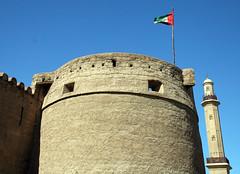 Castle and Mosque (StephenJR) Tags: sky castle museum dubai minaret flag uae middleeast mosque 2008 unitedarabemirates