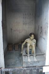 Shackled Mannequin (Augapfel) Tags: museum war cell vietnam jail saigon prisoner hochimin warremnantsmuseum jailcell