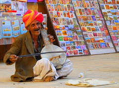 The bard of Patwon-ki-Haveli (... Arjun) Tags: portrait musician 15fav india man colour 1025fav 510fav nikon asia colours 100v10f player 2550fav singer poet writer colourful d200 turban performer oversaturated bard jaisalmer rajasthan conductor composer 2007 haveli alms artiste 65mm lyricist patwonkihaveli 18200mmf3556g bluelist instrumentalist rhymester anawesomeshot diamondclassphotographer flickrdiamond versifier thebardofpatwonkihaveli