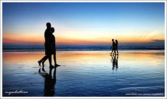 Together to the End? (myudistira) Tags: sunset bali beach work canon couple honeymoon photographer dusk culture made together pairs 2008 kuta freelance adat budaya balinese fotografer unik yudis baliview 400d baliphotographer yudistira diamondclassphotographer myudistira madeyudistira yudist